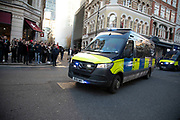 Police vans arrive on the scene asthe City of London is locked down by Metropolitan and City Police following what is believed to have been a terror-related incident on London Bridge at around 2pm on 29th November 2019 in London, United Kingdom. Police officers cordoned off the bridge, underpass and all surrounding roads following the incident during which members of the public intervened before shots were fired by armed police. The incident is said to have started as a stabbing during which a number of people were stabbed in a building near London Bridge.