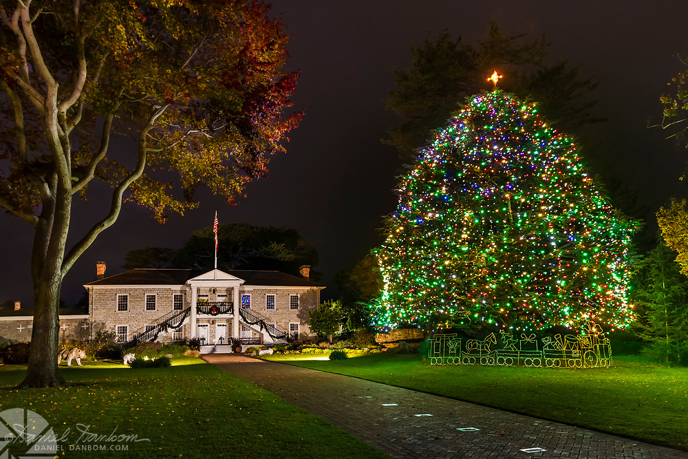 Lighted scene of Colton Hall, the first Capital of California, Monterey, California, with the city Christmas tree.
