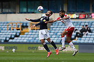 Millwall Forward Mason Bennett(20)  and Bristol City Midfielder Adrian Mariappa (19)  battles for possession during the EFL Sky Bet Championship match between Millwall and Bristol City at The Den, London, England on 1 May 2021.