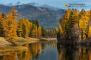 Kayaking in autumn on Jessup Pond in Creston, Montana, USA model released