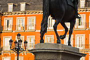 Detail of Felipe (Philip) III's equestrian statue and windows overlooking Plaza Mayor, Madrid, Spain.