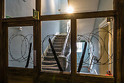 """Barbed wire on Exit stairwell. Scheduled to run through 2018 at York Castle Museum, the First World War Exhibition, """"1914: When the World Changed Forever"""" opened on 28 June 2014, exactly 100 years after Archduke Franz Ferdinand was assassinated, sparking a chain of events leading to war. York Castle Museum was founded in 1938 by Dr John Kirk, a doctor from Pickering, North Yorkshire. The museum houses Kirk's extraordinary collection of social history, reflecting everyday life in the county, including a fullscale Victorian reconstruction of Kirkgate street, a recreated Jacobean dining rooms (1567–1625), a history of children's toys, and exhibits on the First World War through the 1960s. The York Castle Museum is housed in a former debtors' prison (built in 1701–05 using stone from castle ruins) and in an adjoining former women's prison (built 1780–85) in North Yorkshire, England. Originally built by William the Conqueror in 1068, York Castle features a ruined keep now called """"Clifford's Tower."""""""