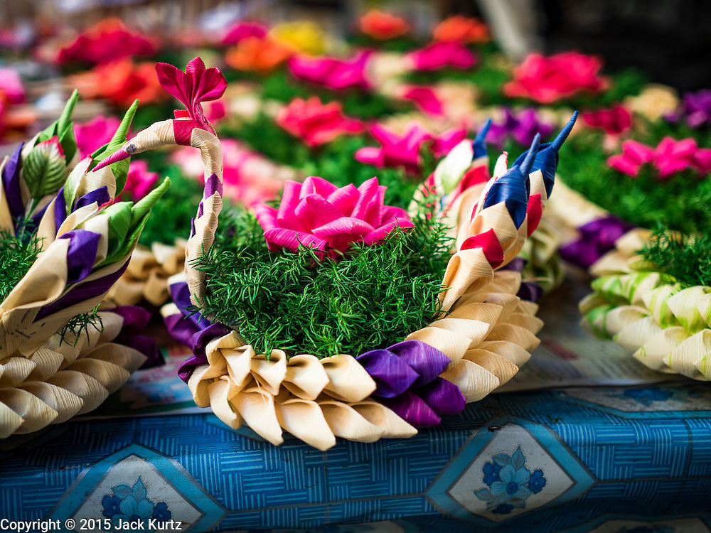 "24 NOVEMBER 2015 - BANGKOK, THAILAND:  ""Krathongs"" for sale in Bang Chak Market. Krathongs are small boats Thais float in canals and bodies of water, on Loy Krathong, a Buddhist holiday on the full moon in November.  The Bang Chak Market serves the community around Sois 91-97 on Sukhumvit Road in the Bangkok suburbs. About half of the market has been torn down. Bangkok city authorities put up notices in late November that the market would be closed by January 1, 2016 and redevelopment would start shortly after that. Market vendors said condominiums are being built on the land.        PHOTO BY JACK KURTZ"