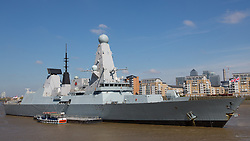 © Licensed to London News Pictures. 22/04/2015.  The Type-45 British destroyer HMS Defender arrived in London in the early hours of this morning for a six day visit. It's the first time that the Daring class vessel has visited London. She is in the capital to mark the centenary of the Battle of Gallipoli. She was seen glistening in the sunny spring weather today at her mooring in Greenwich. Hms Defender is 500ft long and will be leaving London next Tuesday. Credit : Rob Powell/LNP