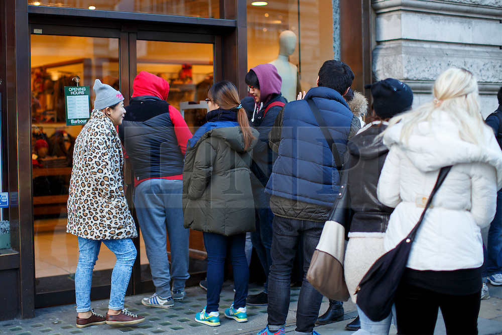 © licensed to London News Pictures. London, UK 26/12/2013. People queueing outside an Abercrombie & Fitch branch on Regent Street, London on Boxing Day. Photo credit: Tolga Akmen/LNP