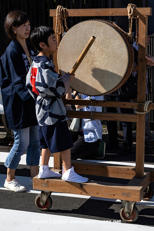 Drummer at Mengake Kamakura - Mengake or Masked Parade at Goryo Jinja shrine.  At this festival held in September a group of ten people take part in this annual ritual: 8 men and 2 women. Wearing comical or grotesque masks that signify different demons, legends and dieties  leave the shrine and parade through the nearby streets accompanied by portable shrine and festival music.