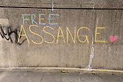 Free Assange graffiti in Waterloo on 11th August 2021 in London, United Kingdom. Following Judge Vanessa Baraitser's earlier ruling that he was a 'suicide risk' if extradited to the US, she denied his extradition. Today, the court ruled that the United States can resume it's appeal to extradite Assange, against this decision. Assange has been held in prison since his conviction in 2019 following approximately 7 years claiming political asylum in the Ecuadorian Embassy in London.