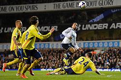 Tottenham's midfielder Aaron Lennon and Sunderland's defender Carlos Cuellar compete for the ball  - Photo mandatory by-line: Mitchell Gunn/JMP - Tel: Mobile: 07966 386802 07/04/2014 - SPORT - FOOTBALL - White Hart Lane - London - Tottenham Hotspur v Sunderland - Premier League
