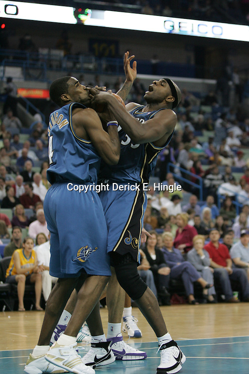 Wizards players Antawn Jamison (left) and Brendan Haywood (right) struggle for a rebound against the New Orleans Hornets on February 25, 2008 at the New Orleans Arena in New Orleans, Louisiana. The New Orleans Hornets lost 95-92 to the Washington Wizards.