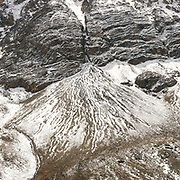 """Afghan Pamir mountains. Down from the Irshad Pass (4950m) into Pakistan's Chapursan valley. Guiding and photographing Paul Salopek while trekking with 2 donkeys across the """"Roof of the World"""", through the Afghan Pamir and Hindukush mountains, into Pakistan and the Karakoram mountains of the Greater Western Himalaya."""
