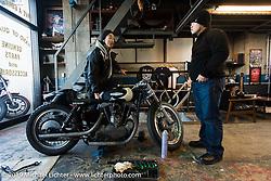 Harley-Davidson design team member Dais Nagao visits with Hideya Togashi at his Hide Motorcycle's shop. Tokyo, Japan. Tuesday, December 9, 2014. Photograph ©2014 Michael Lichter.