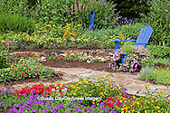 63821-21818 Flower garden with blue Adirondack chair and blue bird house. Butterfly Bushes, Peach & Purple Verbenas, Yellow Lantana (Lantana camara), Karl Forster Grass, Black-eyed Susans (Rudbeckia hirta), Homestead Purple Verbena (Verbena canadensis), Red Verbena, New Gold Lantana (Lantana camara)  Marion Co., IL