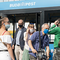 People wearing mask required as part of the COVID-19 preventive regulations travel on a bus in Budapest, Hungary on Sept. 23, 2020. ATTILA VOLGYI