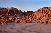 Eroded sandstone rock formations at dusk, Goblin Valley State Park, Utah, at the edge of the San Rafael Desert.