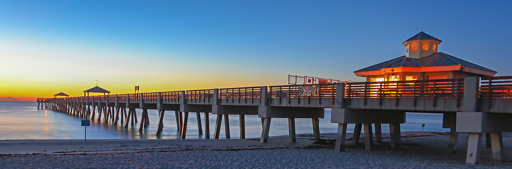 South Florida sunrise panorama photography of Juno Pier and beach in Palm Beach County, FL. This Florida Juno Fishing Pier panorama photography image is available as museum quality photography prints, canvas prints, acrylic prints or metal prints. Fine art prints may be framed and matted to the individual liking and decorating needs:<br /> <br /> http://juergen-roth.pixels.com/featured/juno-beach-fishing-pier-juergen-roth.html<br /> <br /> All Juno Beach Pier Florida panorama photography photos are available for digital and print image licensing at www.RothGalleries.com. Please contact me direct with any questions or request.<br /> <br /> Good light and happy photo making!<br /> <br /> My best,<br /> <br /> Juergen<br /> Prints: http://www.rothgalleries.com<br /> Photo Blog: http://whereintheworldisjuergen.blogspot.com<br /> Twitter: @NatureFineArt<br /> Instagram: https://www.instagram.com/rothgalleries<br /> Facebook: https://www.facebook.com/naturefineart