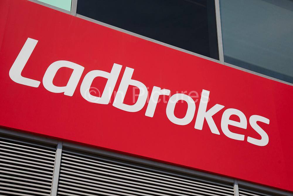 Sign for the gambling brand Ladbrokes in Birmingham, United Kingdom.