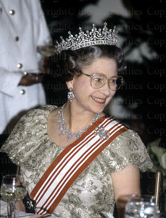 The Queen seen at a state banquet held in her honour during a visit to Singapore in October 1989. Photograph by Terry Fincher