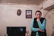 """""""He left for 35 days, he never returned"""" Gulnara Harutian, the widow of Alosha Gregorian (41) remembers when I visited her house after she invited us upon my visit at the local school in Çartar, which is about 47/km far from Stepanakert (Xankendi) in eastern Nagorno Karabakh.<br /> Alosha was reportedly killed in his position by an Azerbaijani shell the family say. """"He was a sniper shooter"""" his father Alihan remembers. Alosha was the father of three children. Two daughters and one son. From the age of 8 from his daughter to 12 years of his son and 15 years of age of his older daughter.<br /> <br /> Gulnara (in picture), now a widow at her late 30's (38 of age) finds it difficult to raise three children alone, with a recently half-built house by the borderline with Azerbaijani armed forces. Although her house is located within the internationally and newly recognised territory of Azerbaijan, she said she is determined to stay there adding that she's got nowhere to go, however having to pay the price of living in fear that quote: """"Azeris diversants might come in the midst of the night and slit our throats while asleep"""".<br /> Gulnara's father died, while her mother is still alive. She was married to Alosha for sixteen years. <br /> She said she's lucky that parents and family of Alosha are still supporting her. However, her emotional and mental wellbeing appears to be devastating, she also feels that she can't help her children who cannot accept that their father is no longer amongst them. She explained that is very difficult to explain this situation to her children because their father is a figure of protection and they feel unprotected now.<br /> During 44 days of the war, the region saw an end of the conflict after a ceasefire agreement was signed by the leaders of Armenia, Russia and Azerbaijan on 9 November to end the military conflict in Nagorno-Karabakh. Azerbaijani government established the Karabakh Region Authority (KRU) for the districts of Nagorno-Karabak"""