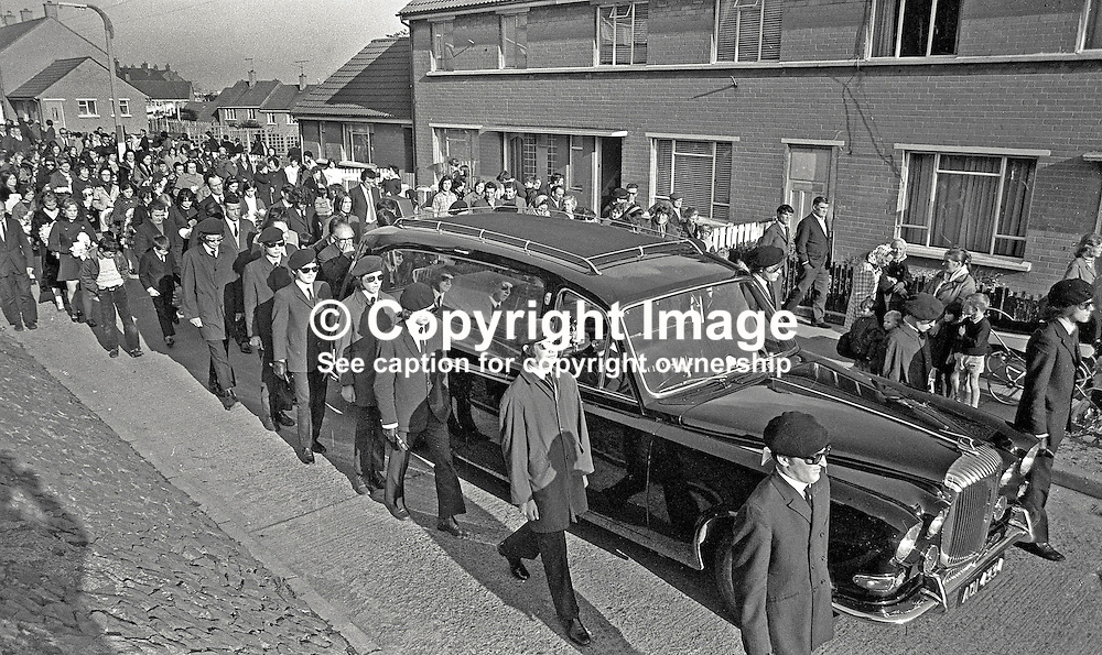IRA-style funeral of Martin Forsythe, who was shot dead by RUC while planting bomb at the Celebrity Club, Belfast, N Ireland, during the Troubles. 452/71, 197110240452b<br /> <br /> Copyright Image from Victor Patterson, Belfast, UK<br /> <br /> t: +44 28 9066 1296 (from Rep of Ireland 048 9066 1296)<br /> m: +44 7802 353836<br /> e: victorpattersonbelfast@gmail.com<br /> <br /> www.images4media.com<br /> <br /> Please see my full Terms and Conditions of Use at https://www.images4media.com/p/terms-conditions - it is IMPORTANT that you familiarise yourself with them.<br /> <br /> Images used online incur an additional cost. This cost should be agreed in writing in advance. Online images must be visibly watermarked i.e. © Victor Patterson or that of the named photographer within the body of the image. The original metadata must not be deleted from images used online.<br /> <br /> This image is only available for the use of the download recipient i.e. television station, newspaper, magazine, book publisher, etc, and must not be passed on to a third party. It is also downloaded on condition that each and every usage is notified within 7 days to victorpattersonbelfast@gmail.com.<br /> <br /> The right of Victor Patterson (or the named photographer) to be identified as the author is asserted in accordance with The Copyright Designs And Patents Act (1988). All moral rights are asserted.