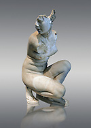 Aphrodite Crouching whilst bathing. The Goddess of love Aphrodite, Venus to the Romans is depicted crouching whilst bathing, she looks to one side as if surprised by something. In this style of Aphrodite statue her arms stretch across in front of her and her right hand gently touches her right shoulder. This statue is a  2nd century Roman copy of a lost Greek. Hellanistic original of the mid 3rd century BC attributed to the Greek sculptor Doldalsas of Bethynia. This version of Aphrodite Bathing made around AD 117-138 is the most artistically successful version know. Capitoline Museums, Rome..<br /> <br /> If you prefer to buy from our ALAMY STOCK LIBRARY page at https://www.alamy.com/portfolio/paul-williams-funkystock/greco-roman-sculptures.html . Type -    Capitoline    - into LOWER SEARCH WITHIN GALLERY box - Refine search by adding a subject, place, background colour, etc.<br /> <br /> Visit our ROMAN WORLD PHOTO COLLECTIONS for more photos to download or buy as wall art prints https://funkystock.photoshelter.com/gallery-collection/The-Romans-Art-Artefacts-Antiquities-Historic-Sites-Pictures-Images/C0000r2uLJJo9_s0