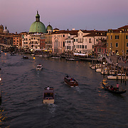 Twilight over the Grand Canal in Venice, Italy accentuates the color of the ancient buildings.