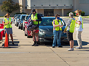 29 MAY 2020 - DES MOINES, IOWA: Volunteers wait for a produce distribution to start in a mall parking lot in Des Moines. The Des Moines Area Religious Council (DMARC) and Capitol City Fruit from Norwalk, IA, gave away 1,800 boxes of fresh produce with a mix of vegetables and fruit. The boxes contain enough produce to feed a family of four for a week. The produce was provided by the USDA Farmers to a Families food program. The unemployment rate in Iowa hit 10.2% in May, the highest unemployment rate ever recorded in Iowa.         PHOTO BY JACK KURTZ
