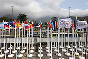"""Rio de Janeiro. BRAZIL.  Nations flags caught in the wind as the storm which has hit the 2016 Olympic Rowing Regatta. Lagoa Stadium,<br /> Copacabana,  """"Olympic Summer Games""""<br /> Rodrigo de Freitas Lagoon, Lagoa.   Sunday  07/08/2016 <br /> <br /> [Mandatory Credit; Peter SPURRIER/Intersport Images]"""
