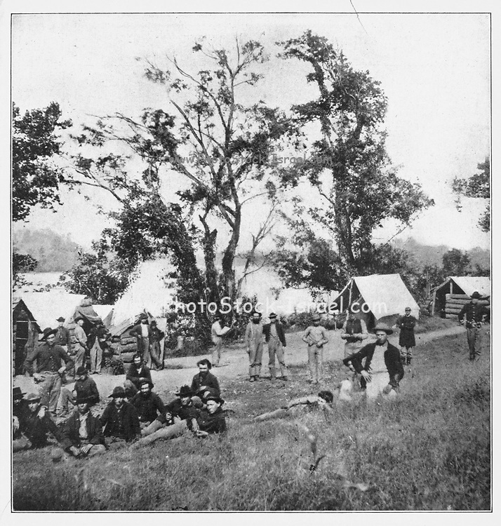 """At this point, where Citico Creek joins the Tennessee, the left of the Eleventh Corps of the Army of the Cumberland rested on the river bank, the limit of the Federal line of defense, east of Chattanooga. Here, on high ground overlooking the stream, was posted Battery McAloon to keep the Confederates back from the river, so that timber and firewood could be rafted down to the besieged army. In the chill of autumn, with scanty rations, the soldiers had a hard time keeping warm, as all fuel within the lines had been consumed. The Army of the Cumberland was almost conquered by hardship. Grant feared that the soldiers """"could not be got out of their trenches to assume the offensive."""" But it was these very men who achieved the most signal victory in the battle of Chattanooga. from the book ' The Civil war through the camera ' hundreds of vivid photographs actually taken in Civil war times, sixteen reproductions in color of famous war paintings. The new text history by Henry W. Elson. A. complete illustrated history of the Civil war"""