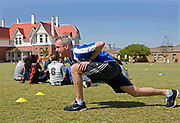 "Norman Cook warms up in football attire in South Africa where he is helping the charity, Coaching for Hope. In 2006 Norman Cook aka ""Fatboy Slim"" agreed to be the patron of Coaching for Hope.  His record company ""Skint"" had long been the sponsors of Brighton and Hove Albion, one of the football clubs that has supported Coaching for Hope from the start. The charity is an innovative programme, which uses football to create better futures for young people in West and Southern Africa."