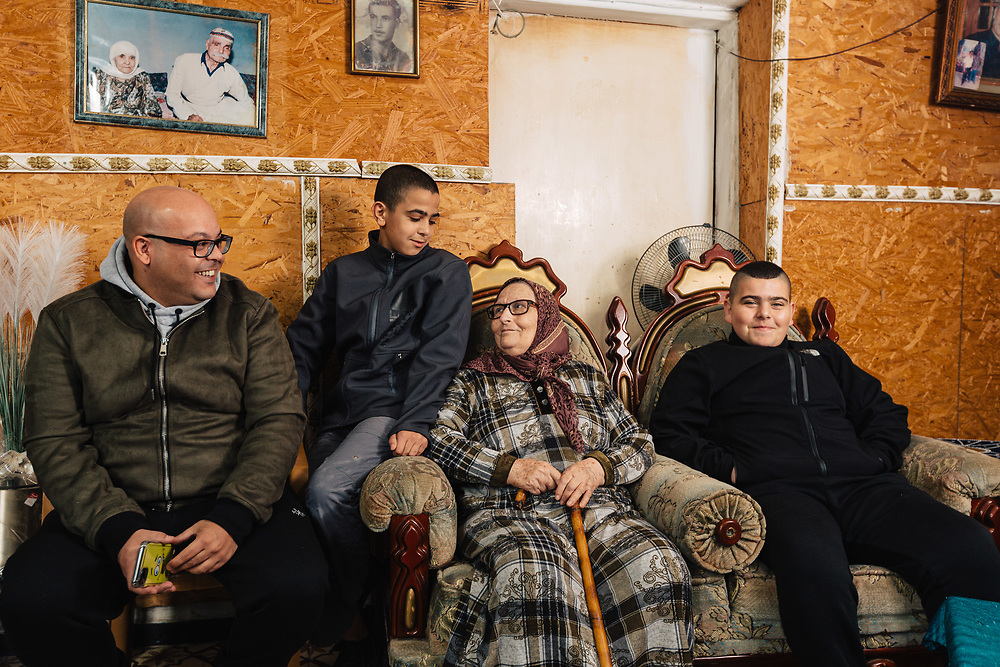 Leila Jabarin, 78, and her grandchildren Aladdin (L), Mohammed (2nd L), and Khaled (R), pose for a photograph at their home in the Arab town of Umm al-Fahm, Israel, on January 07, 2020.