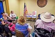July 14 - PEORIA, AZ: Members of the Tea Party wait for JD Hayworth to address them in a hotel meeting room in Peoria, AZ. Hayworth spoke to a Tea Party gathering in a hotel meeting room in Peoria. Hayworth, an ultra conservative, is running to the right of McCain and has painted McCain as a moderate to liberal Senator in the mold John Kerry (D-MA).     Photo by Jack Kurtz