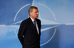 BRUSSELS, BELGIUM - FEB-22-2005 - NATO Secretary General Mr. Jaap de Hoop Scheffer waits to receive the heads of state and government from the 26 NATO countries as they arrive at Alliance Headquarters in Brussels on 22 February for a discussion on transatlantic issues at the  highest level.<br />  (PHOTO © JOCK FISTICK)