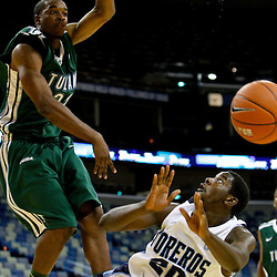 November 27, 2011; New Orleans, LA; Tulane Green Wave guard/forward Kendall Timmons (22) blocks a shot by San Diego Toreros guard Cameron Miles (20) during the second half of the Hoops for Hope Classic at the New Orleans Arena. Tulane defeated San Diego 65-46. Mandatory Credit: Derick E. Hingle-US PRESSWIRE