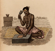 Goldbeater producing gold leaf: India.  Hand-coloured engraving published Rudolph Ackermann, London, 1822.