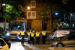 © Licensed to London News Pictures. 26/06/2020. London, UK. Police in riot equipment leave the scene after attempting to disperse an illegal Street Party at Riverton Close in Maida Vale, West London.  A number of similar events have occurred across the capital, with some resulting in violence towards police. Photo credit: Ben Cawthra/LNP