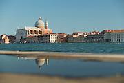 Looking across Canale della Diudecca at II Redentore on Giudecca. A 16th-century Roman Catholic church. Venice, Italy