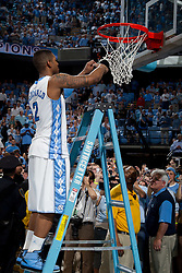 CHAPEL HILL, NC - MARCH 05: Leslie McDonald #2 of the North Carolina Tar Heels cuts down the net after defeating the Duke Blue Devils and winning the regular season ACC championship on March 05, 2011 at the Dean E. Smith Center in Chapel Hill, North Carolina. North Carolina won 67-81. (Photo by Peyton Williams/UNC/Getty Images) *** Local Caption *** Leslie McDonald