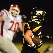 Topsail's Grant McCoy runs for extra yards after an interception.