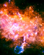 This image is taken looking towards a region of our Milky Way galaxy in the Eagle constellation, closer to the galactic center than our sun. At the center and the left of the image, the two massive star-forming regions G29.9 and W43 are clearly visible. Herschel.
