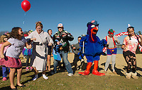 Tom Turkey warms up the crowd with some dance moves prior to the Salvation Army's 8th annual Turkey Plunge Saturday afternoon in Opechee Cove.  (Karen Bobotas/for the Laconia Daily Sun)