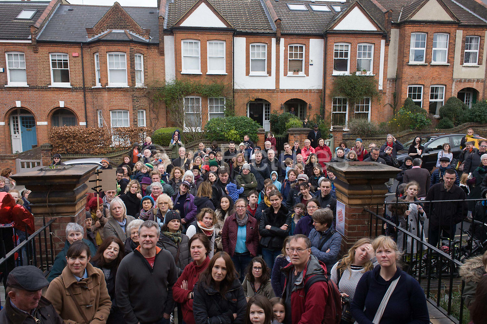 Faced with the closure of its beloved local library, the people of Herne Hill, Lambeth, south London block the road while protesting outside the Edwardian property. Lambeth council plan to close the facility used by the community as part of austerity cuts, saying they will convert the building into a gym and privately-owned gentrified businesses - rather than a much-loved reading and learning resource. £12,600 was donated by the American philanthropist Andrew Carnegie to help build the library which opened in 1906. It is a fine example of Edwardian civic architecture, built with red Flettan bricks and terracotta, listed as Grade II in 1981.