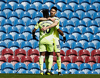 Football - 2020 / 2021 Premier League - Burnley vs. Newcastle United<br /> <br /> Federico Fernandez congratulates Allan Saint-Maximin after he set up the equaliser for Jacob Murphy, at Turf Moor.<br /> <br /> <br /> COLORSPORT/ALAN MARTIN