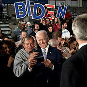 Democratic presidential candidate Joe Biden takes a selfie with a supporter after a primary night event at the University of South Carolina's Carolina Volleyball Center in Columbia, S.C., on Saturday, February 29, 2020.