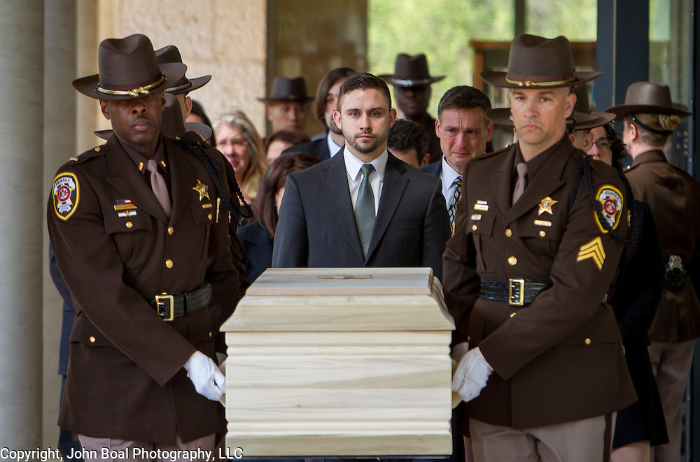 Grace Mann's casket is carried to the hearse outside Temple Rodef Shalom, in Falls Church, on Tuesday, April 21, 2015.  Over 1100 mourners gathered to memorialize Mann, a student at Mary Washington University, a victim of an apparent homicide on Friday afternoon in Fredericksburg.  For the (Fredericksburg, VA) Free Lance-Star.