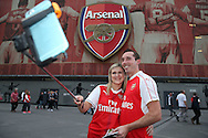 two Arsenal fans pose to take a photo with a selfie stick outside the Emirates Stadium before k/o . UEFA Champions league group A match, Arsenal v FC Basel at the Emirates Stadium in London on Wednesday 28th September 2016.<br /> pic by John Patrick Fletcher, Andrew Orchard sports photography.