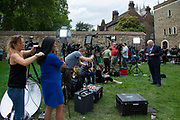 A broadcaster has her hair brushed before going on camera on College Green on 24th May 2019 in London, England, United Kingdom. Todays announcement by Britains Prime Minister to step down on the 7th June has started a leadership race in the Conservative Party.