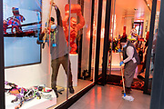 As England finishes its second Coronavirus pandemic lockdown, and London enters a Tier 2 restriction, cleaning staff at 'Galerie Richard Orlinski' in Bond Street, wipe window surfaces and floors before the first customers return to the West End to start their Christmas shopping, on 2nd December 2020, in London, England.
