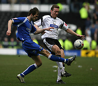 Photo: Pete Lorence.<br />Derby County v Cardiff City. Coca Cola Championship. 17/03/2007.<br />Cardiff's Roger Johnson (L) clears the ball past Steve Howard.