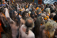 Hundreds of Naga Sadhus gathered in the compound of Maya Devi Temple, befoe going in a procession to take a holy dip in the ganges.<br /> <br /> Kumbh Mela, 2010, Haridwar, Uttarakhand.