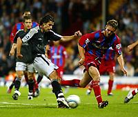 Photo. Chris Ratcliffe. Digitalsport<br /> Crystal Palace v Chelsea. Barclays Premiership. 24/08/2004<br /> Cardoso Tiago scoring the second goal - Mark Hudson of Crystal Palace